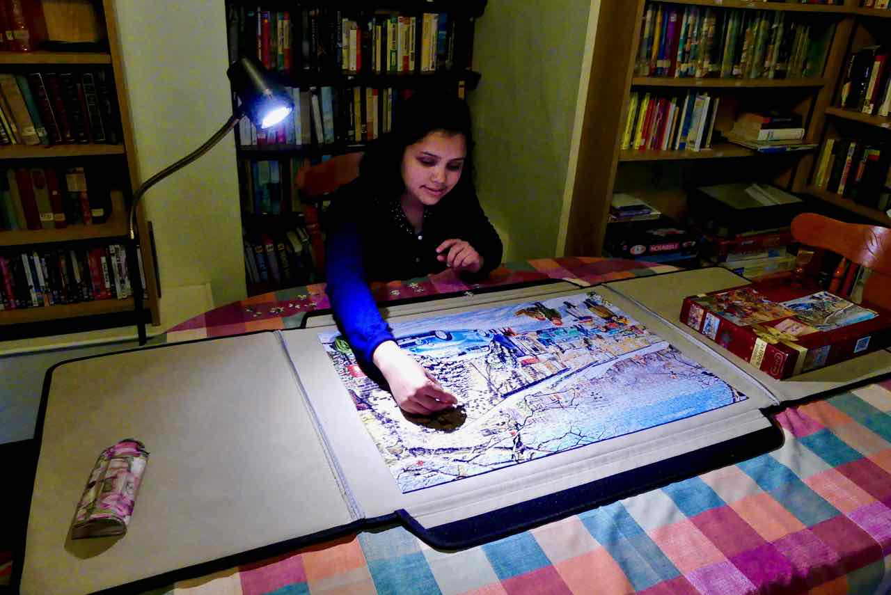 Nirmala concentrates on the jigsaw