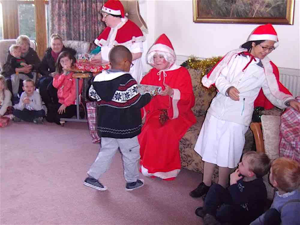 Children Receive From Mother Christmas